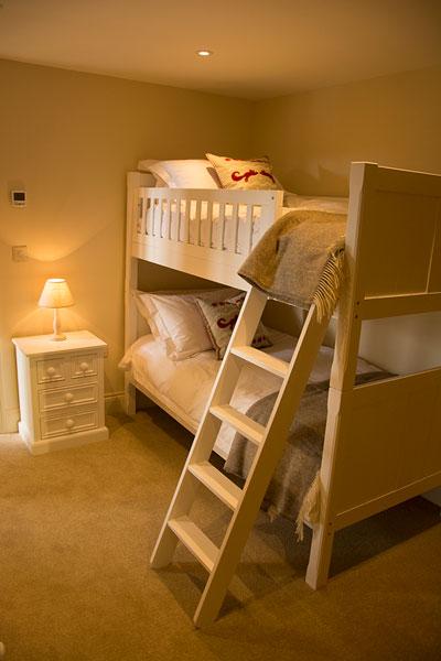 bunk ensuite bedroom with tv